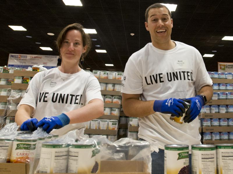 Volunteers in T-shirts Live United