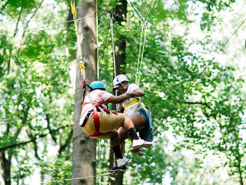 two women in treetops at retreat